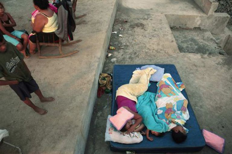 People in Managua sleep outdoors, in accordance with the government's request.