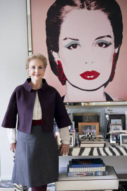 Carolina Herrera in front of Andy Warhol's portrait that dominates her show room and which she paid for with a bejeweled clutch that Warhol had admired at a New York party.