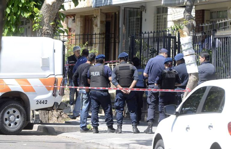 Police at the triple murder scene in Mendoza, Argentina.
