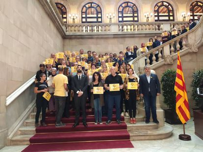 Pro-independence political parties stage a silent protest inside the Catalan Parliament.