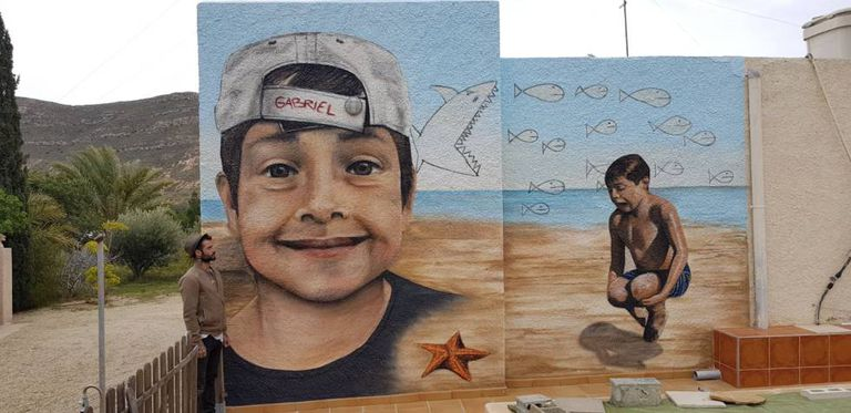 Mural honoring the memory of Gabriel Cruz, made by Mikel Herrero (pictured) and Olaia Chocarro.