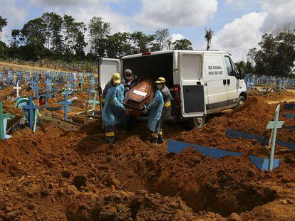Cemetery workers burying a coronavirus victim in Manaus, Amazonas state, Brazil, on January 6.
