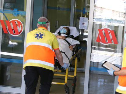 A woman is carried on a stretcher at Arnau de Vilanova hospital in Lleida.