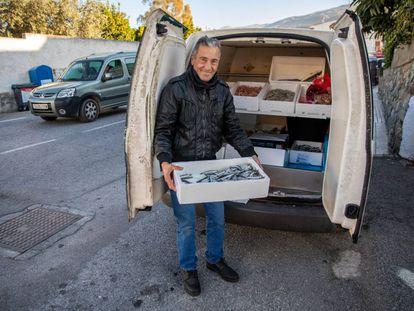 José Manuel Aguilar sells fresh fish from his van in the village of Lecrín.