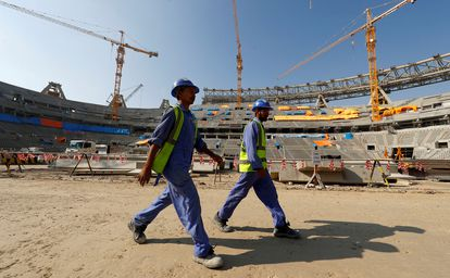 Workers in Doha, Qatar on a construction site for a stadium for the 2022 FIFA World Cup.