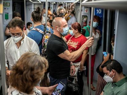 Dozens of passengers on Line 10 of the Madrid Metro system.