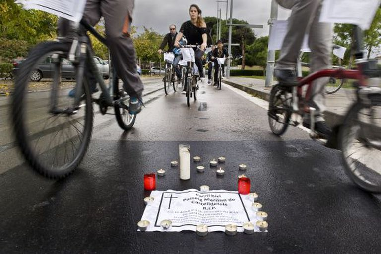 Members of the Catalonia Bicycle Club mourn the loss of a bike lane.