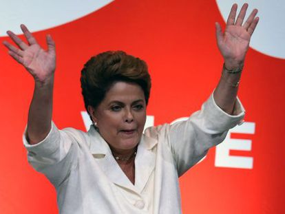 Brazilian President Dilma Rousseff waves after her win on Sunday.