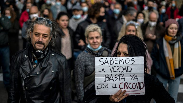 """Protest of coronavirus deniers in Madrid on November 7. Sign reads: """"We know the truth. Enough of the circus-virus."""""""