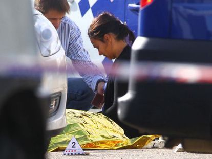 A woman weeps over the body of the man.
