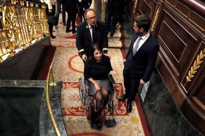 Adriana Lastra of the PSOE is taken out in a wheelchair after spraining her ankle.
