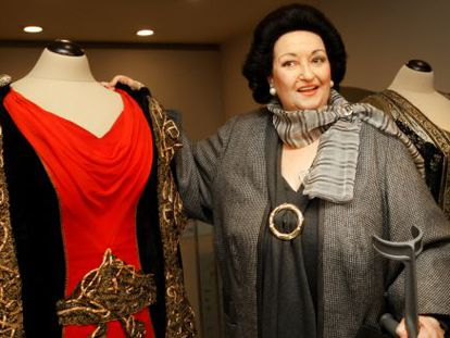 Montserrat Caballé poses next to dresses worn during her performances.