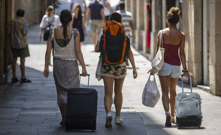 Three tourists in Barcelona.