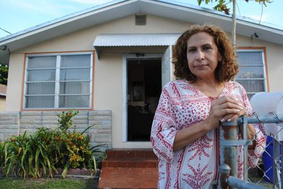 María Edith Lau outside her house in Miami.