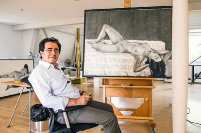 The architect in his studio. He spends his mornings drawing and painting.