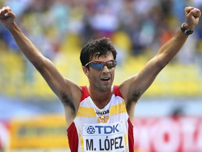 Miguel Ángel López celebrates his third-placed finish in the 20-kilometer walk.