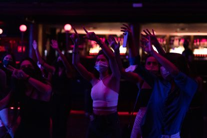 Patrons dancing in the early hours of Saturday at Sala Apolo in Barcelona.