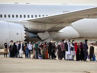 A group of Afghans arrives at the Torrejón de Ardoz air base on Tuesday.