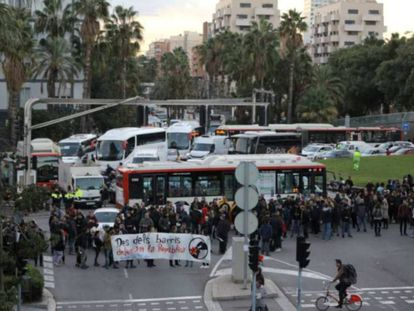 Protesters block a street in Barcelona during the strike on October 3.