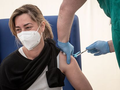 A health worker receives the AstraZeneca vaccine in Valencia.