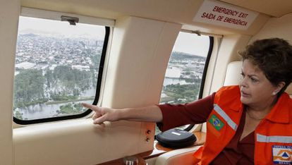 Dilma Rousseff surveys flooded areas of Brazil by helicopter on Christmas Eve.