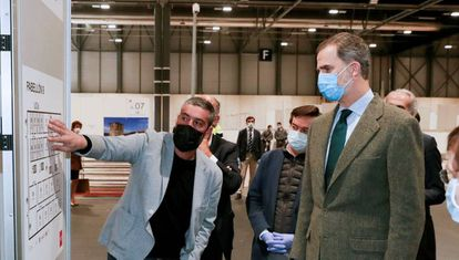 King Felipe visits the field hospital in Madrid's IFEMA convention center.