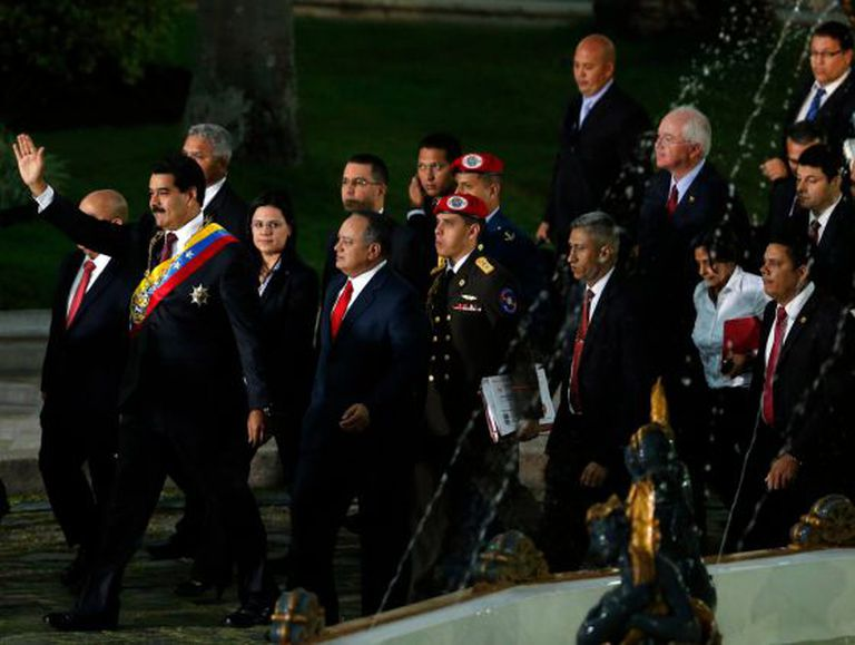 Venezuela's President Nicolás Maduro, front left, greets supporters upon his arrival for his annual state-of-the-nation address to the National Assembly.