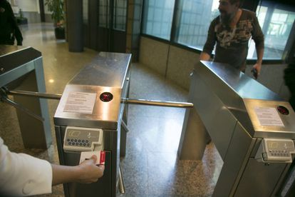Workers sign in to the offices of public television station Telemadrid.