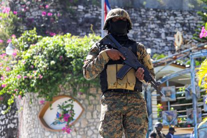 A police officer standing guard outside the presidential residence after the assassination of Jovenel Moïse on July 7.