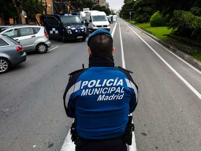Municipal police in Madrid carry out traffic stops in April.