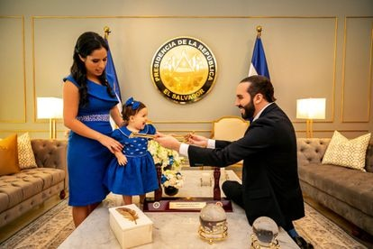 Bukele with his wife, Gabriela Rodríguez, and their daughter in the presidential office.
