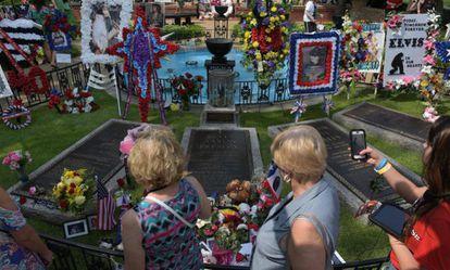 Elvis Presley fans visit his grave in Memphis on August 12.