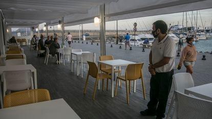 A near-empty restaurant in the port of Corralejo, Fuerteventura in Spain's Canary Islands.