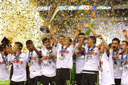 Mexico's national team members celebrate their Sunday night victory in Philadelphia.