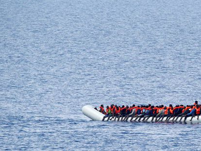 Immigrants await a rescue ship in the Mediterranean on June 18.