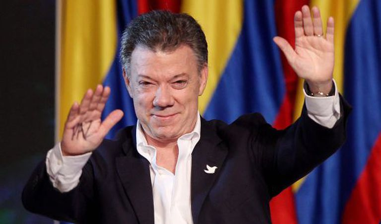 Juan Manuel Santos greets supporters after his victory on Sunday.