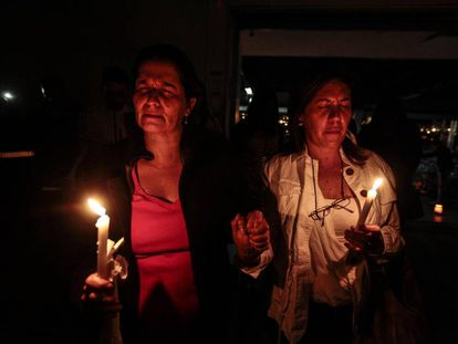 Women hold a vigil in memory of the victims of the April 16 earthquake.