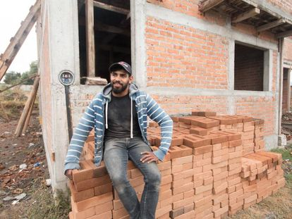Daniel Escobedo oversees construction of a house funded by money sent from the US.