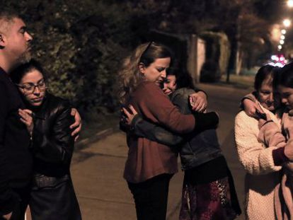 A group of Chileans waits in the street after the quake.