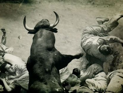 An image from the documentary of a bull colliding with a group of runners in the alley that leads into the Pamplona bullring.