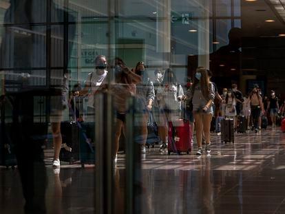 Passengers arriving at Barcelona's El Prat airport on Monday.