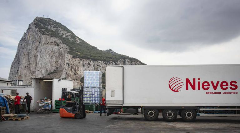 Spanish workers drop off goods near Gibraltar airport.