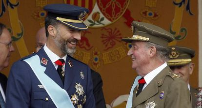 King Felipe and his father, King Juan Carlos, in a file photo.