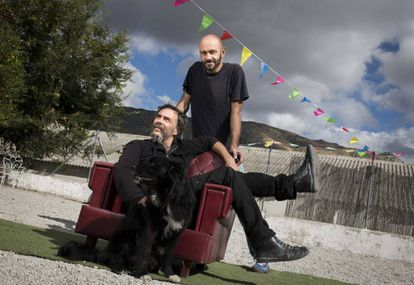 """Mariano Rabadán, 46, (seated) and Ignacio Yuste, 44, both moved from Madrid to Bustarviejo where they run the Nave Indeleble, an artists' cooperative. They say that despite being a small town, many creative people are coming to live here, attracted by the cultural activity. """"The peaceful pace of life helps with inspiration,"""" says Rabadán."""