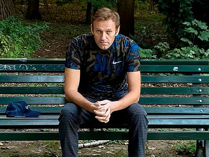 Russian opposition leader Alexei Navalny sitting on a bench in Berlin on September 23.