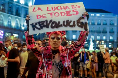 A protester at an earlier march against homophobic attacks, held in Madrid on Tuesday before it emerged that the alleged victim had made up his story.