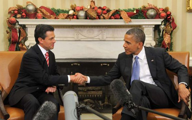 Obama and then President-elect Peña Nieto shake hands during a meeting at the White House in 2012.