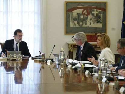 Spanish PM Mariano Rajoy (left) at Saturday's emergency Cabinet meeting.