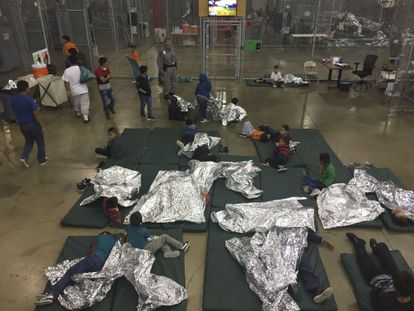 This file photo from June 17, 2018 provided by US Customs and Border Protection shows underage migrants in one of the cages at a detention center in McAllen, Texas.