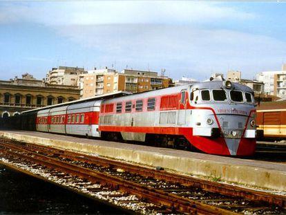 A Talgo train leaves a Spanish rail station.
